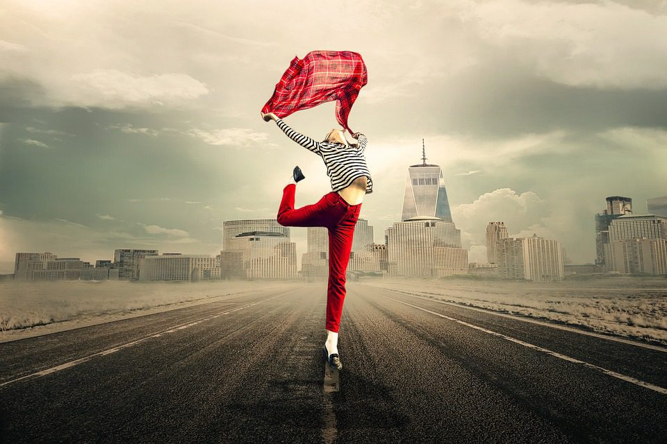 Lady standing on deserted road